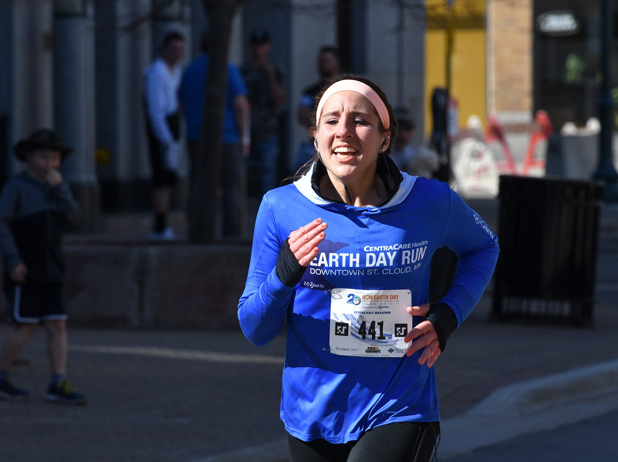 Megan Frisbie approaches the finish line during the Cetera Half Marathon Saturday, April 20, in downtown St. Cloud.