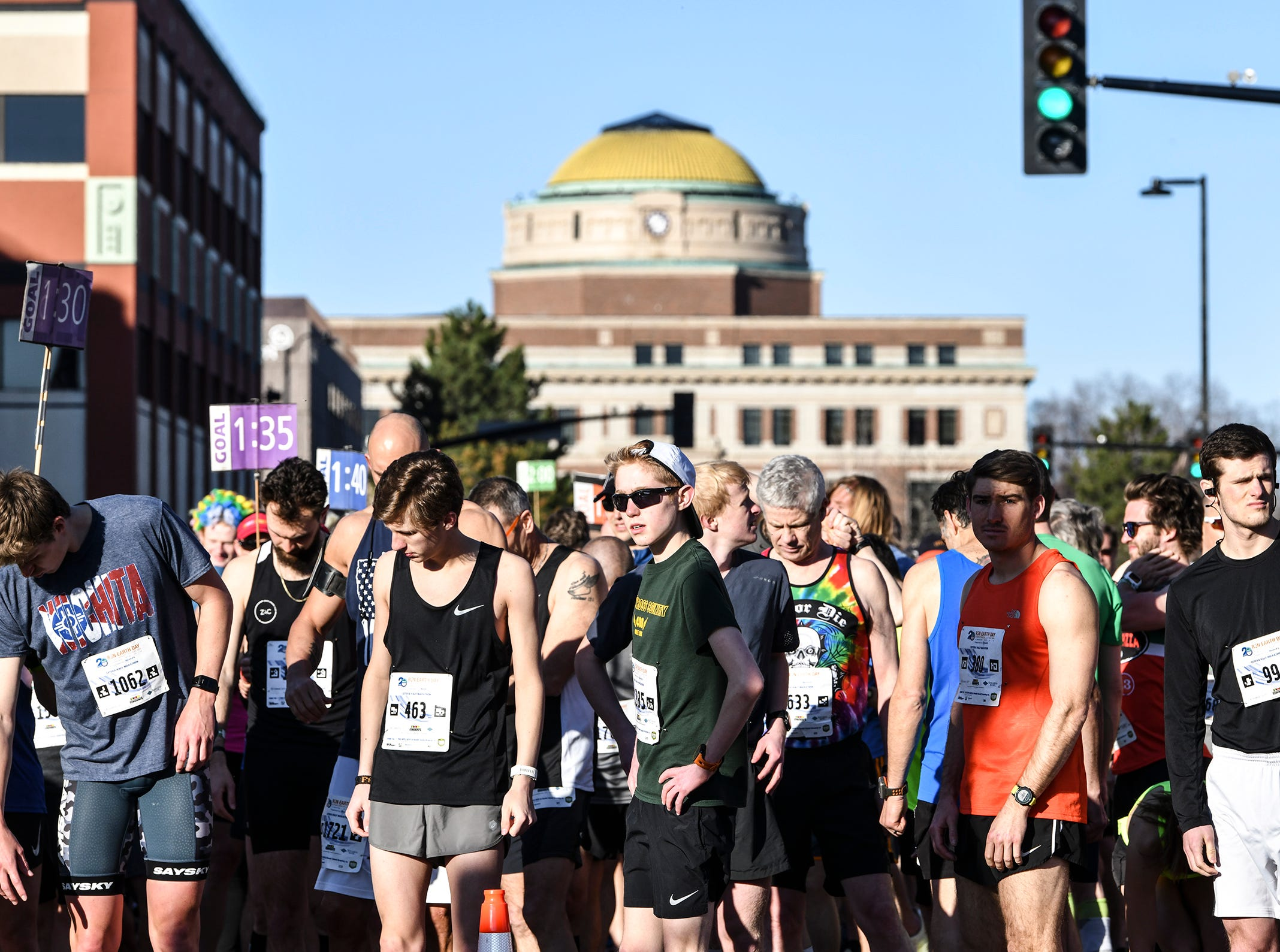 Runners prepare for the of the Cetera Half Marathon Saturday, April 20, in downtown St. Cloud.