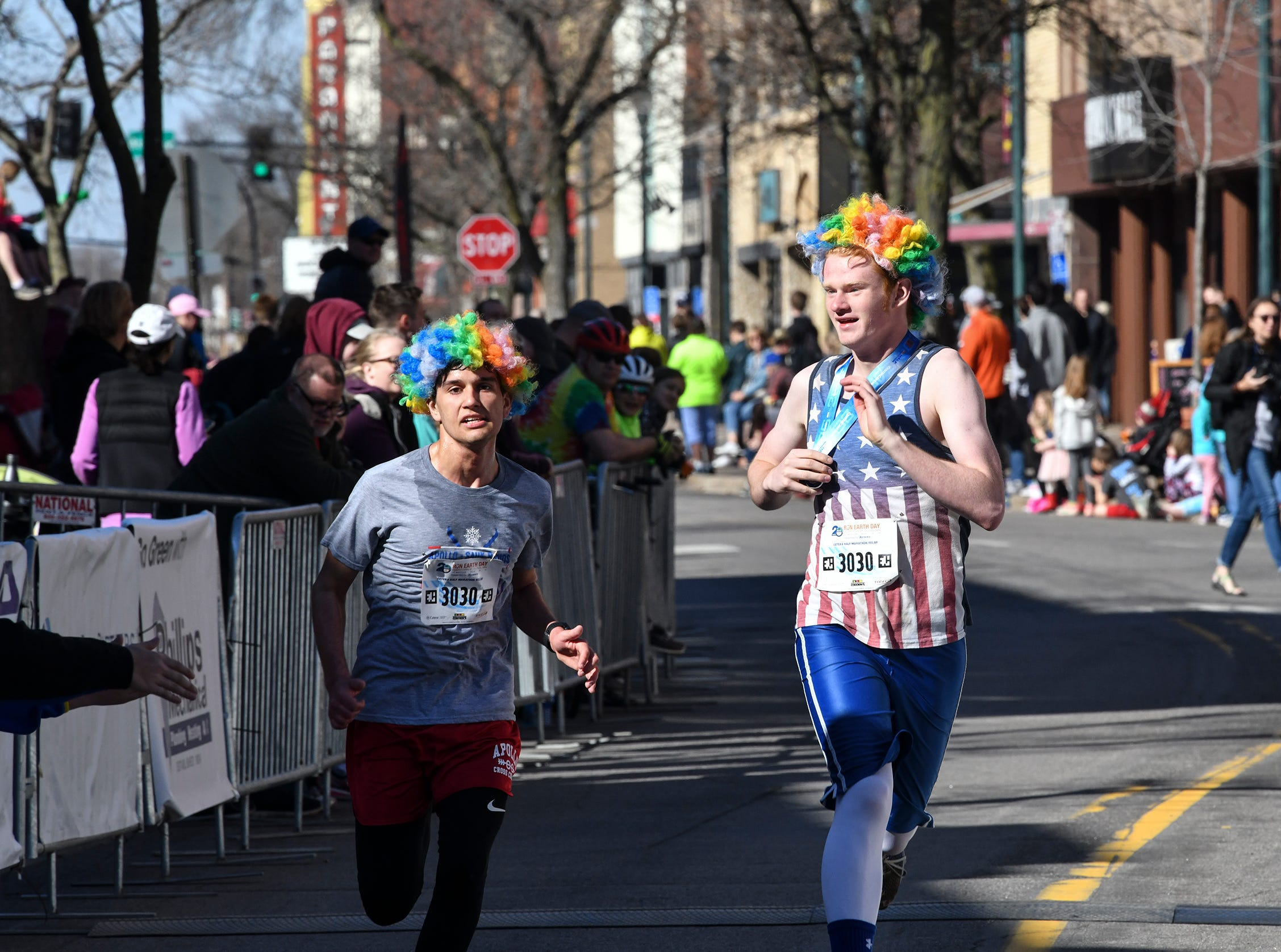 Sam Brewer and Ethan Logeman approach the finish line during the Cetera Half Marathon as part of CentraCare Health Earth Day Run activities Saturday, April 20, in downtown St. Cloud.