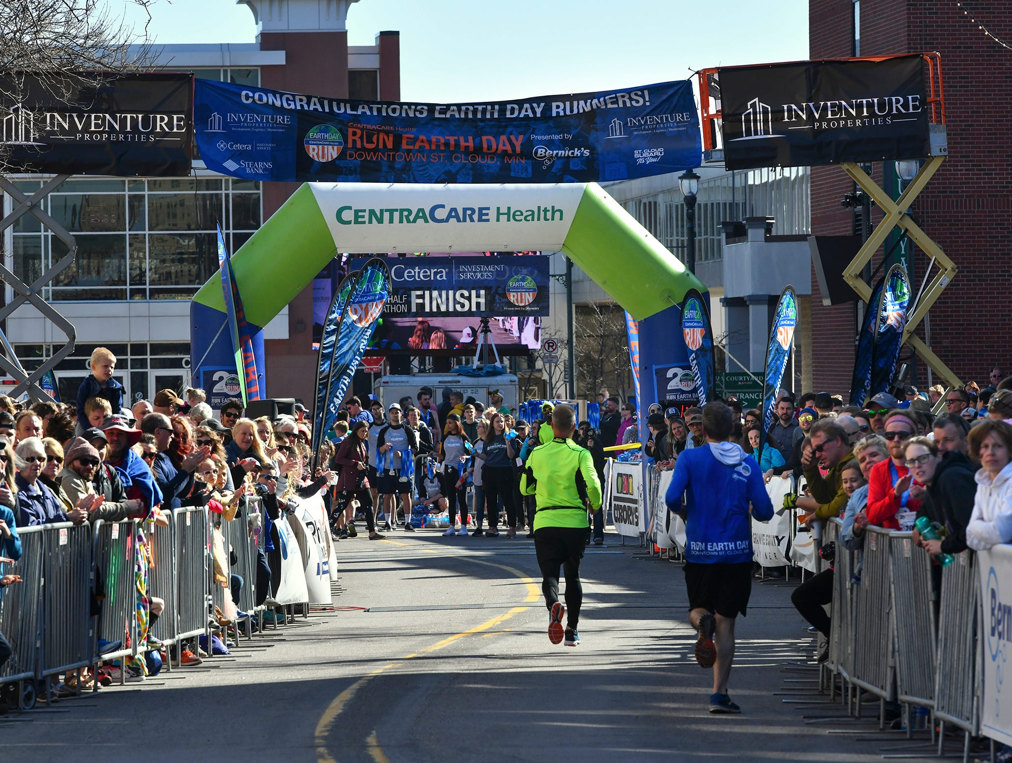 Runners approach the finish line near the River's Edge Convention Center on St. Germain Street during the Cetera Half Marathon as part of CentraCare Health Earth Day Run activities Saturday, April 20, in downtown St. Cloud.