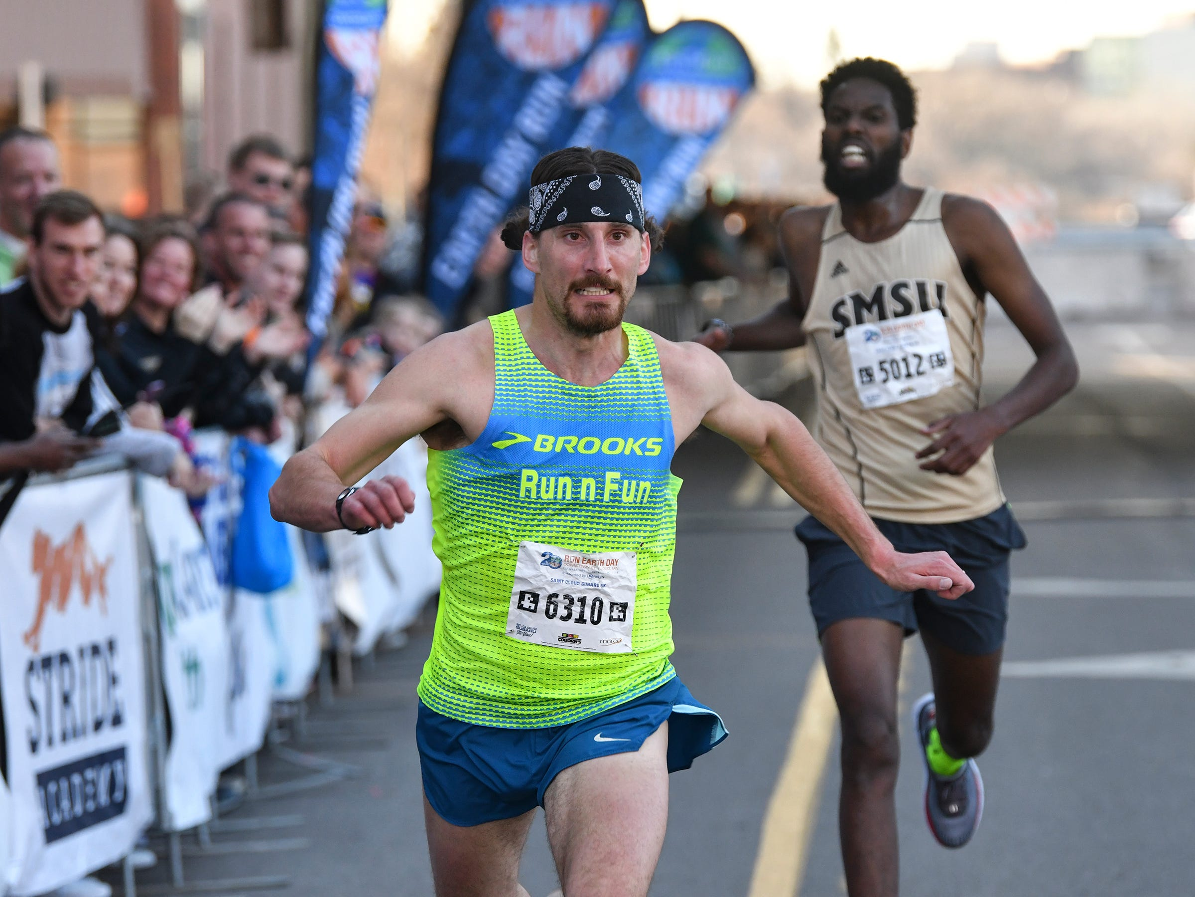 Jonathan Stoltman was the first place finisher in the St. Cloud Subaru 5K run/walk Friday in downtown St. Cloud with a time of 16:25.