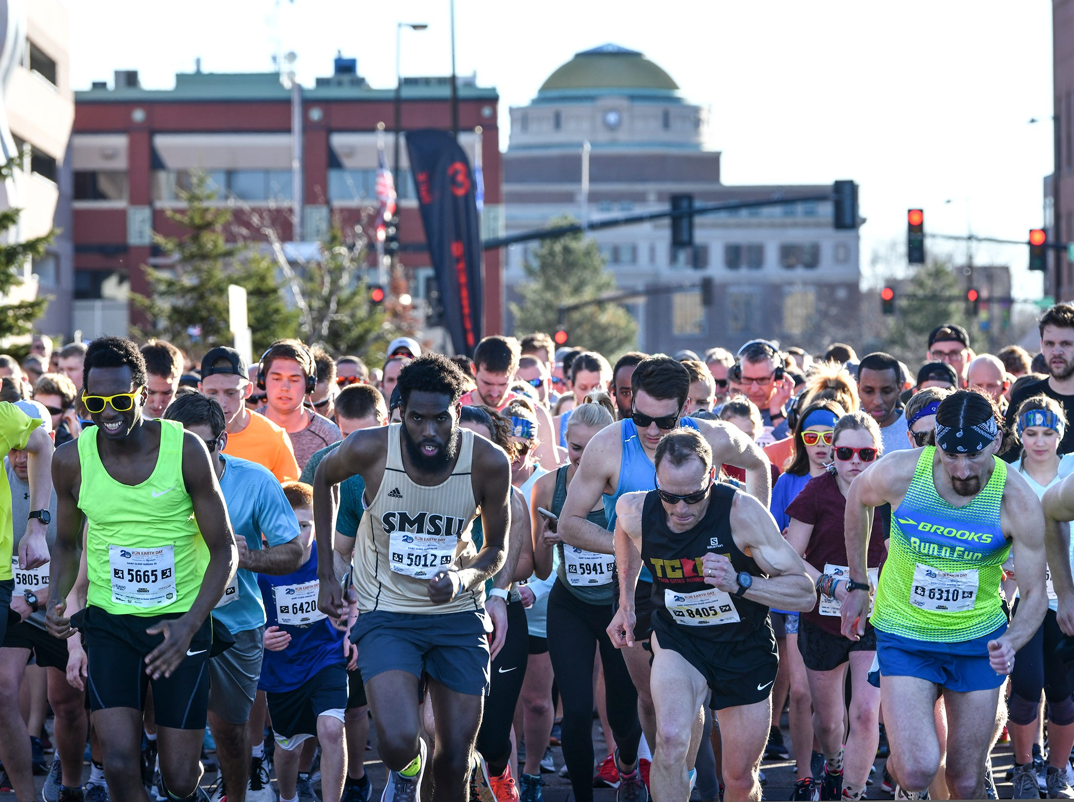 Runners in the first wave leave the starting line of the St. Cloud Subaru 5K run/walk Friday in downtown St. Cloud.