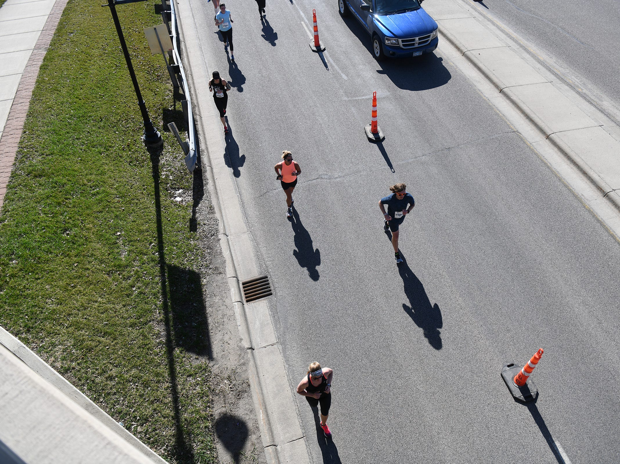 Runners follow the course under the Minnesota Highway 23 underpass during the Cetera Half Marathon as part of CentraCare Health Earth Day Run activities Saturday, April 20, in downtown St. Cloud.