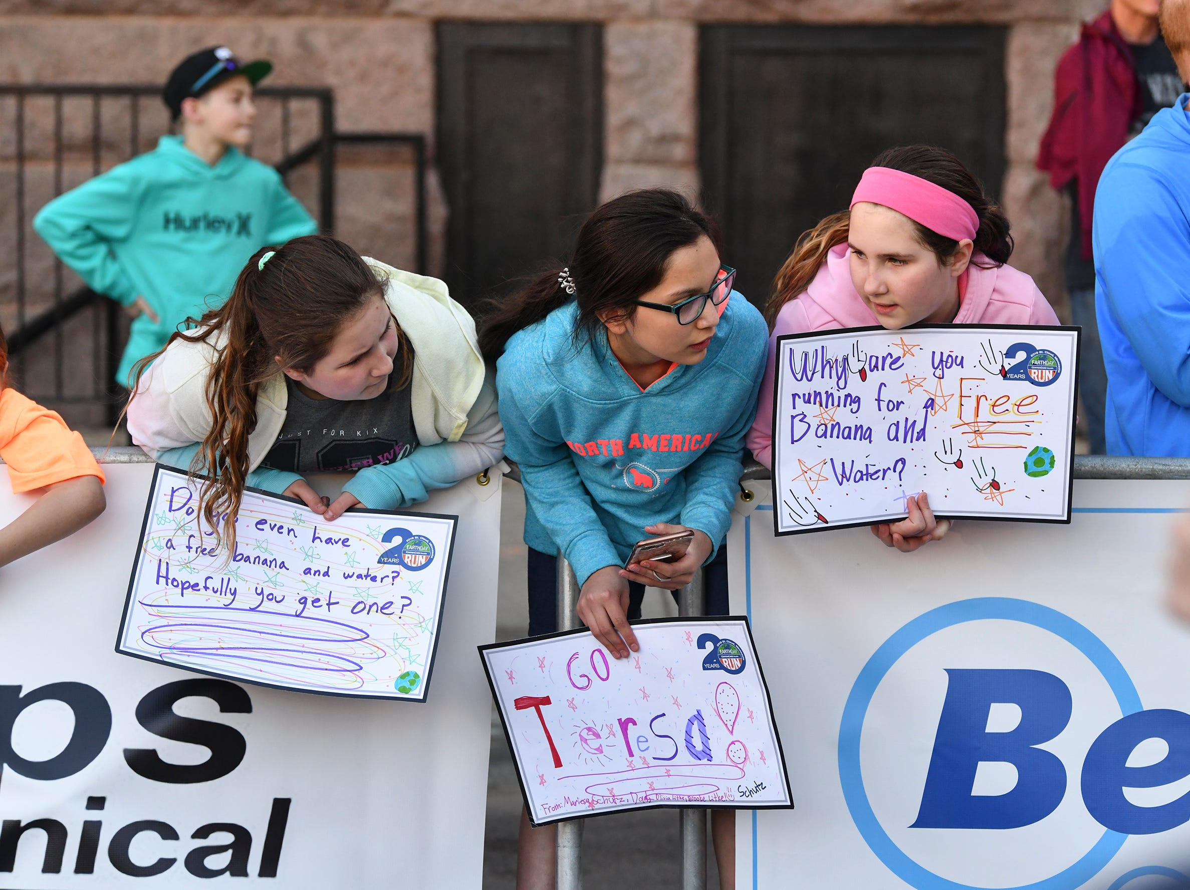 Runners are cheered on near the finish line of the St. Cloud Subaru 5K run/walk Friday in downtown St. Cloud.