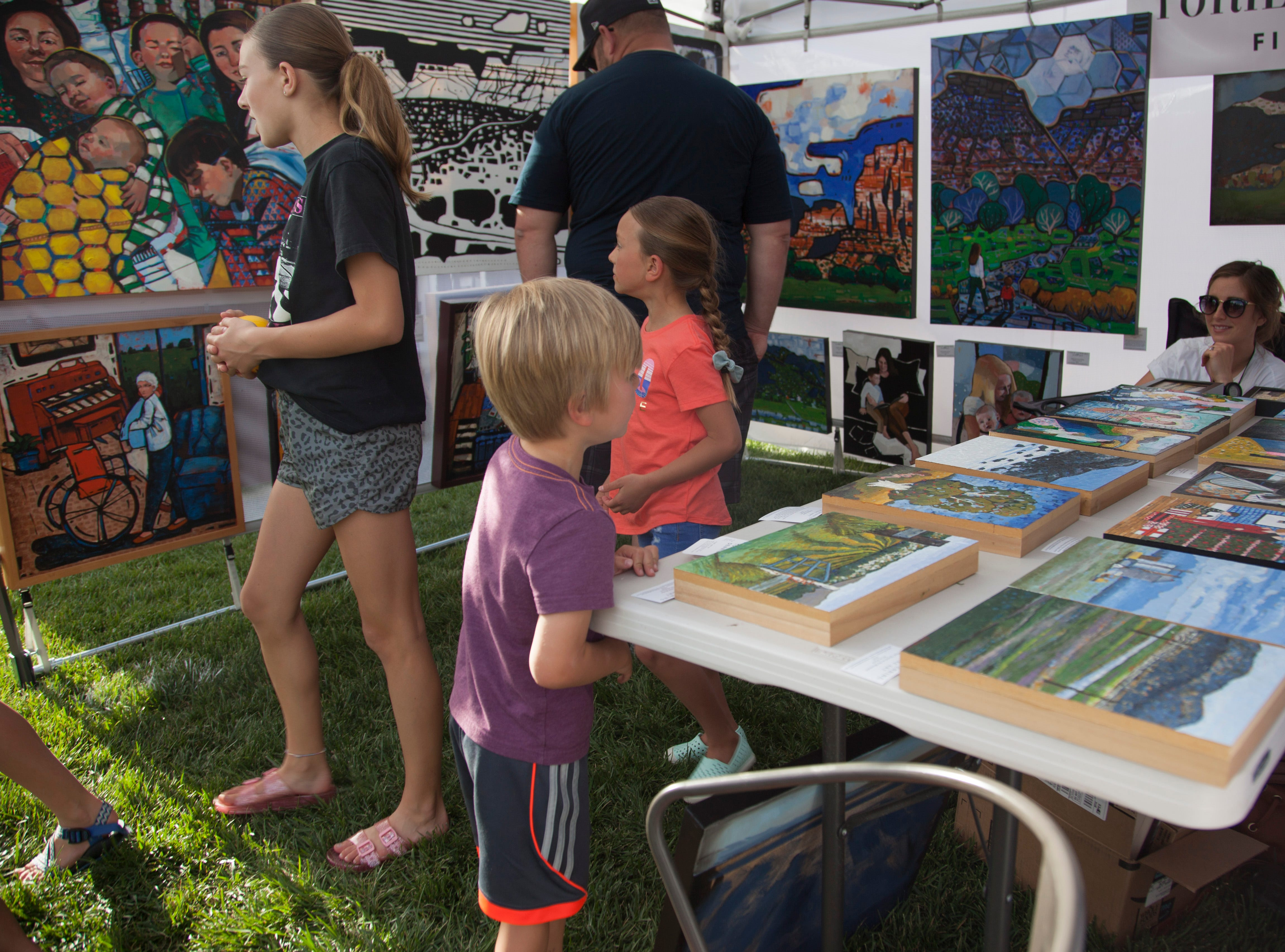 Community members enjoy art and entertainment at the St. George Art Festival Friday, April 19, 2019.