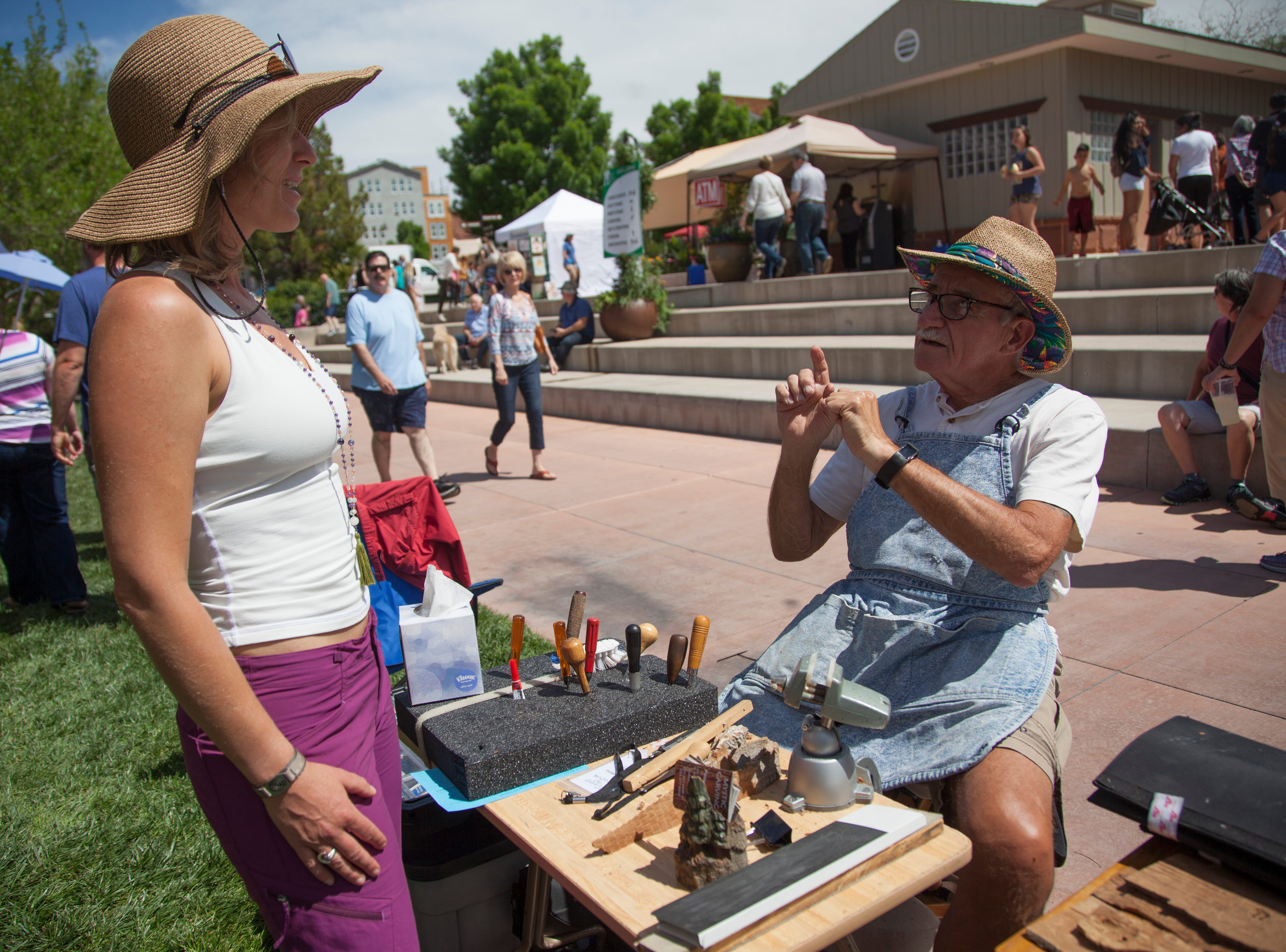 Community members enjoy art and entertainment at the St. George Art Festival Saturday, April 20, 2019.