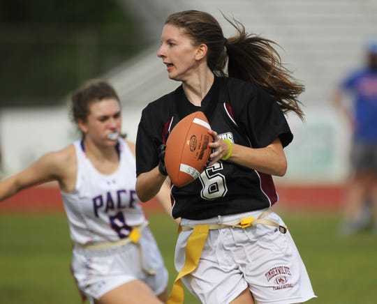 Chiles senior quarterback Rachel Myrick rolls left to throw a pass as Chiles recorded a 20-14 win over Pace on Wednesday, April 17, 2019.