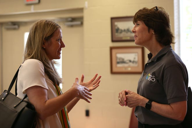 Cissy Proctor, managing partner of the Tallahassee office for LSN Partners, left, speaks with Gwen Graham, cochair of Rebuild 850, before a briefing session at the CalhounC county Public Library in Blountstown, Fla. Wednesday, April 17, 2019.
