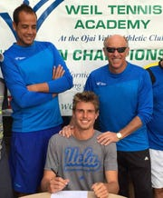 Max Cressy, then a student at Weil Tennis Academy & College Preparatory School in Ojai, signs his letter of intent to play at UCLA alongside head coach Mohamed Badran and director Mark Weil in 2014.