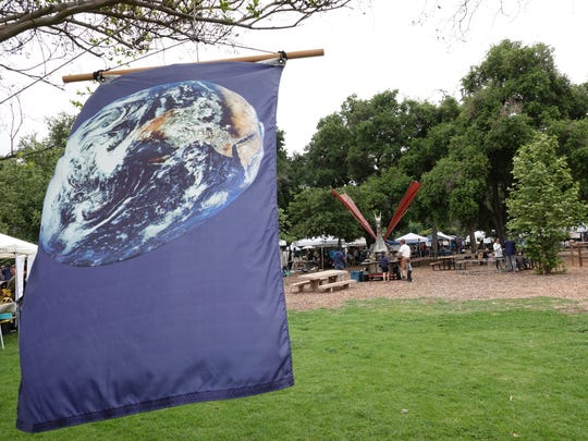 A banner waves at a past Ojai Earth Day in Libbey Park.