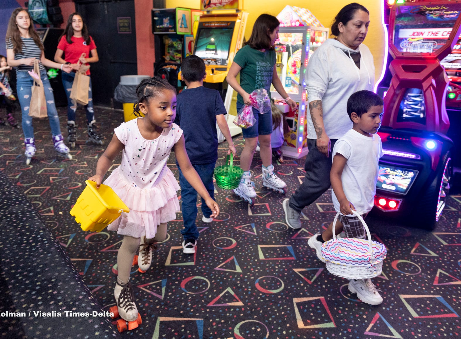 Aniessa Sanders, 6, left, and other skaters at Roller Towne in Visalia raced for candy and prizes during their pre-Easter egg hunt on Friday, April 19, 2019.