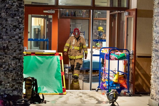 Visalia Fire Department investigates a water flow alarm at Riverway Elementary School on Friday, April 19, 2019. Several classrooms were flooded.