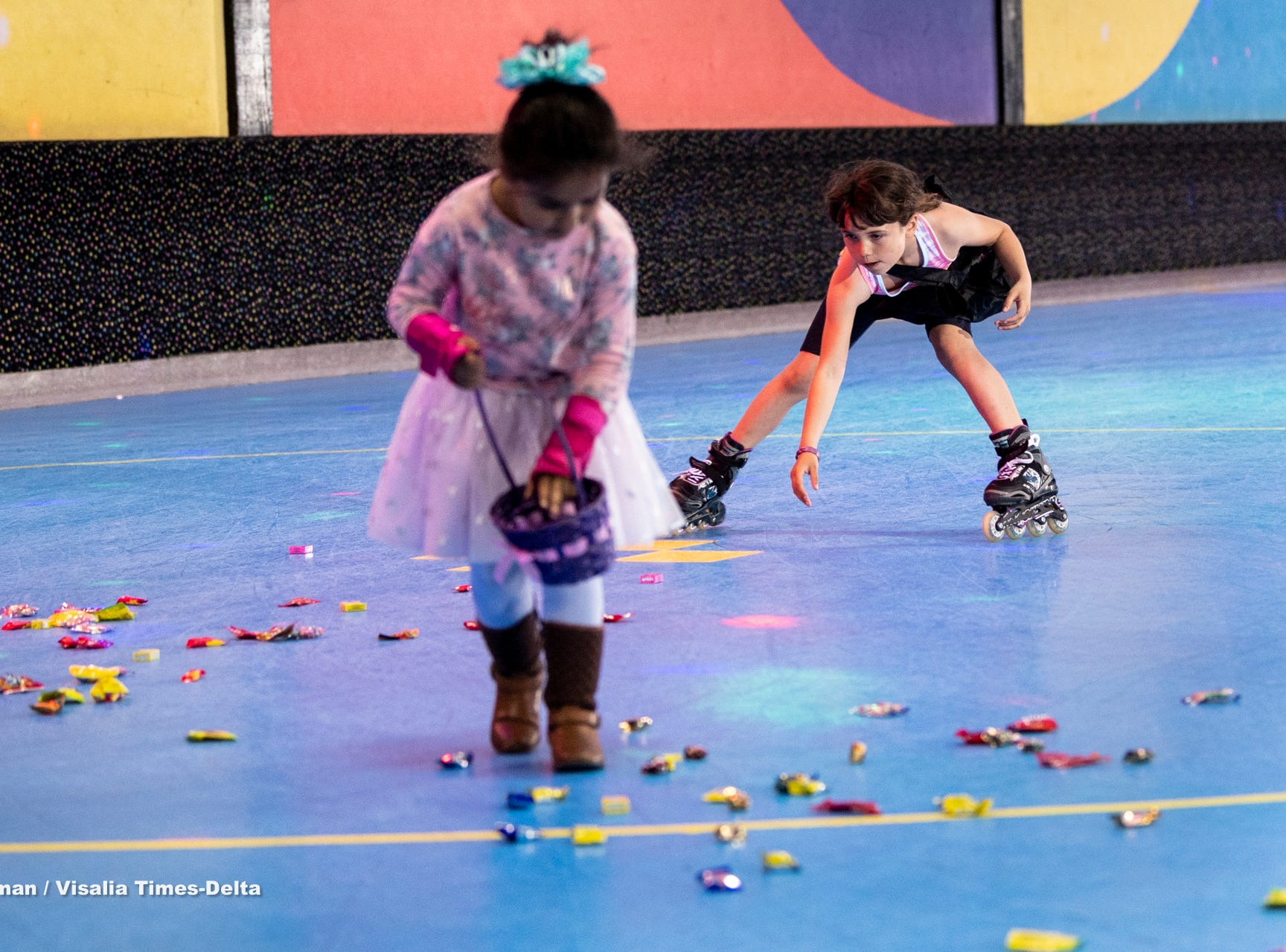 Avery Hernandez, 7, skates in to gather candy at Roller Towne in Visalia during their pre-Easter egg hunt on Friday, April 19, 2019.