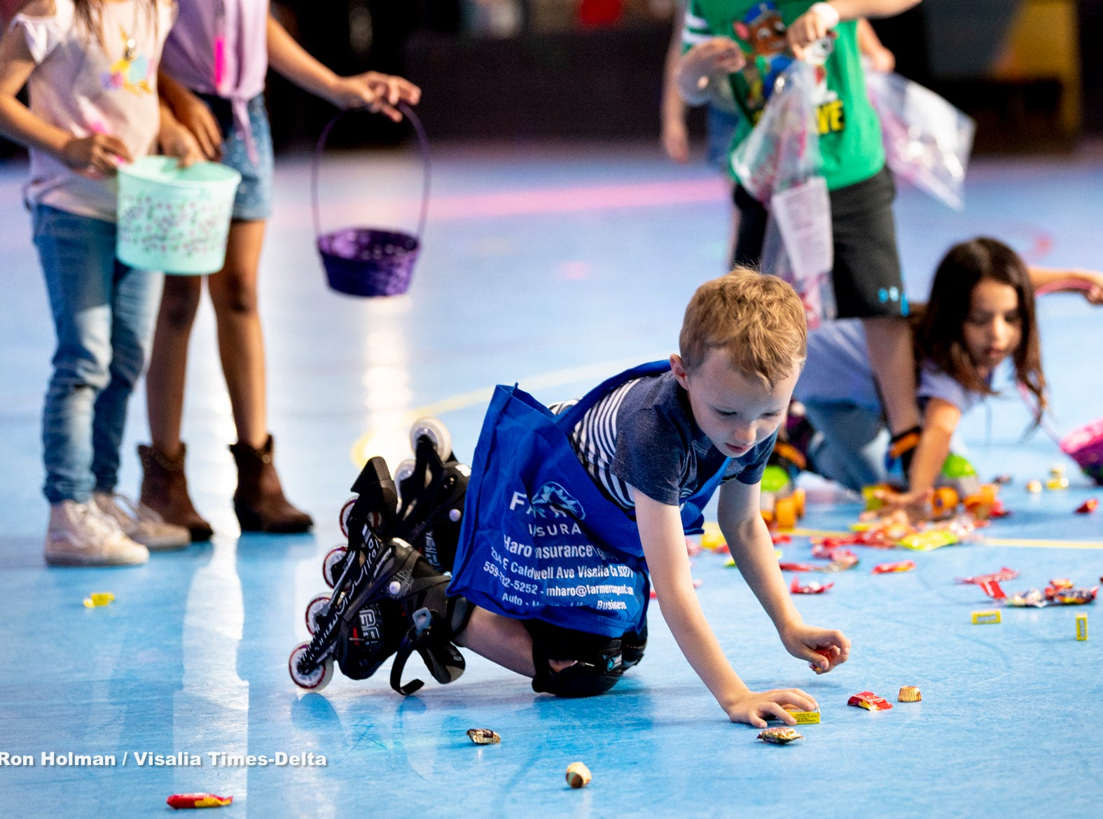 Luke Arsenaulz, 6, and other skaters at Roller Towne in Visalia scramble for candy and prizes during their pre-Easter egg hunt on Friday, April 19, 2019.