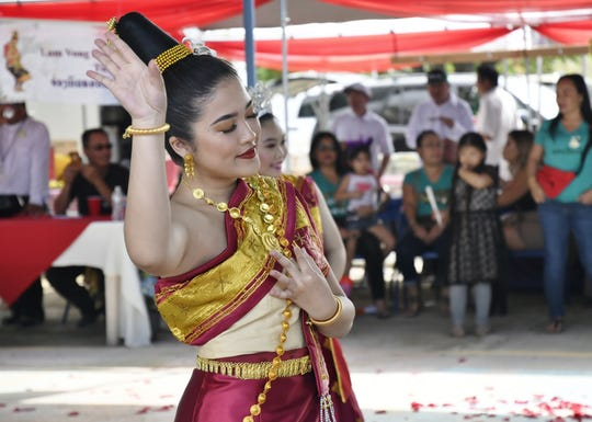 A dancer with Fresno-based Lao Cultural Classes performs at the Lao New Year Celebration at the Lao Buddhist Temple of Visalia on Saturday, April 20, 2019.