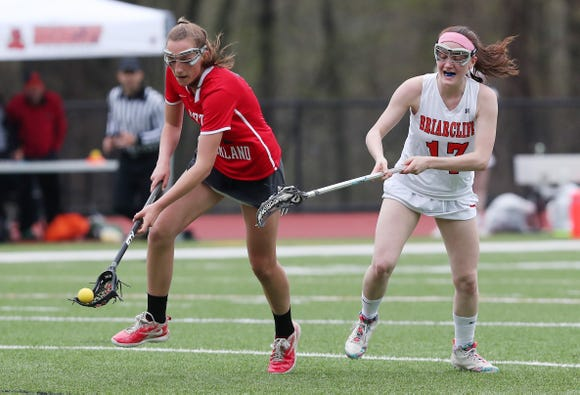 North Rockland's Graze Mallozi (11) breaks away from Briarcliff's Kendall Hayes (17) during girls lacrosse action at Briarcliff High School April 20, 2019. North Rockland won the game.
