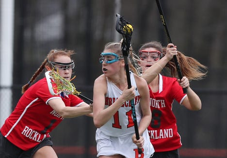 North Rockland's Phoebe Malarkey (1) and Jenna MacMillan (8) put pressure on  Briarcliff's Julia Dalessandro (11) during girls lacrosse action at Briarcliff High School April 20, 2019. North Rockland won the game.