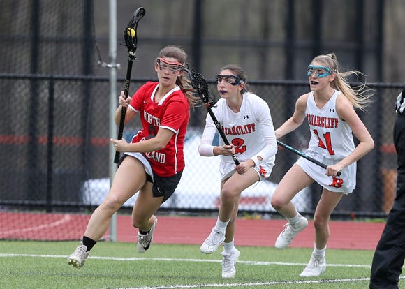 North Rockland's Jenna MacMillan (8) turns the corner on  Briarcliff's Cassie Lawler (2) and Julia Dalessandro (11) during girls lacrosse action at Briarcliff High School April 20, 2019. North Rockland won the game.