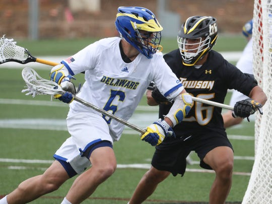 Delaware's Charlie Kitchen (left) moves against Towson's Koby Smith in the Blue Hens' 14-12 loss at Delaware Stadium Saturday.