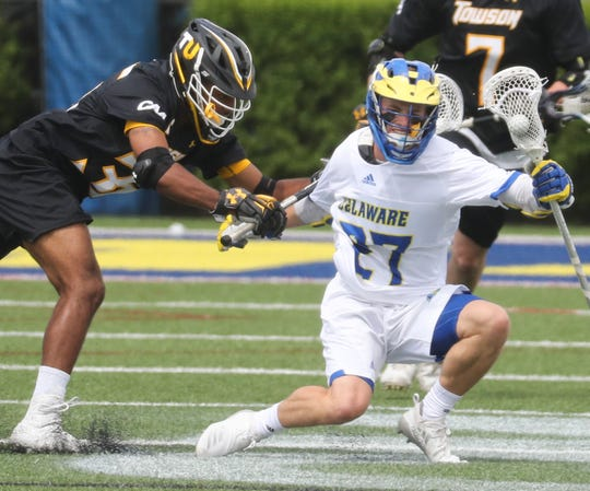 Towson's Jimmie Wilkerson (left) slows Delaware's Bryce Reid in the Blue Hens' 14-12 loss at Delaware Stadium Saturday.