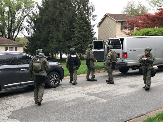 Police in heavy gear on Robin Drive near Hockessin on Saturday morning. A man reported to be armed and suicidal was captured in the area.