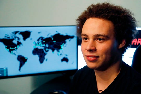 This 2017 file photo shows Marcus Hutchins, a British cybersecurity expert during an interview in Ilfracombe, England. The British cybersecurity researcher hailed as a hero for credited with stopping a worldwide computer virus in 2017 has pleaded guilty to developing malware to steal banking information.