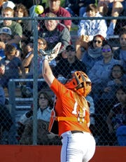 Burkburnett's Cassidy Summers catches the popup for the out against Vernon Friday, April 19, 2019, in Burkburnett. The Lady Lions defeated the Lady Bulldogs 5-2.
