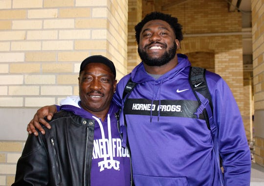 L.J. Collier and his father Lawrence after TCU's 2018 game against Oklahoma State.