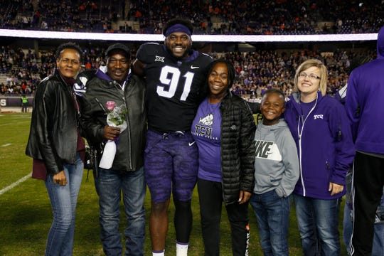 L.J. Collier poses with his family on Senior Day after TCU's win over Oklahoma State. From left to right are Alfredda Davis, his father Lawrence, L.J., Collier, his sister Missy, nephew Tay  and Munday ISD teacher Christel Shahan.