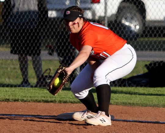 Burkburnett's Callie Riley gets the ball for the out against Vernon Friday, April 19, 2019, in Burkburnett. The Lady Lions defeated the Lady Bulldogs 5-2.