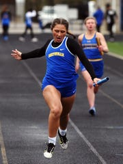 Maysville's Briana Swope crosses the finish line in the 4x100 relay at the Wayne Clark Invitational.