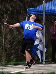 Maysville's Braden Brock heaves a personal-record throw of 163-8 to win the discus at the Wayne Clark Invitational on Friday at John D. Sulsberger Memorial Stadium.