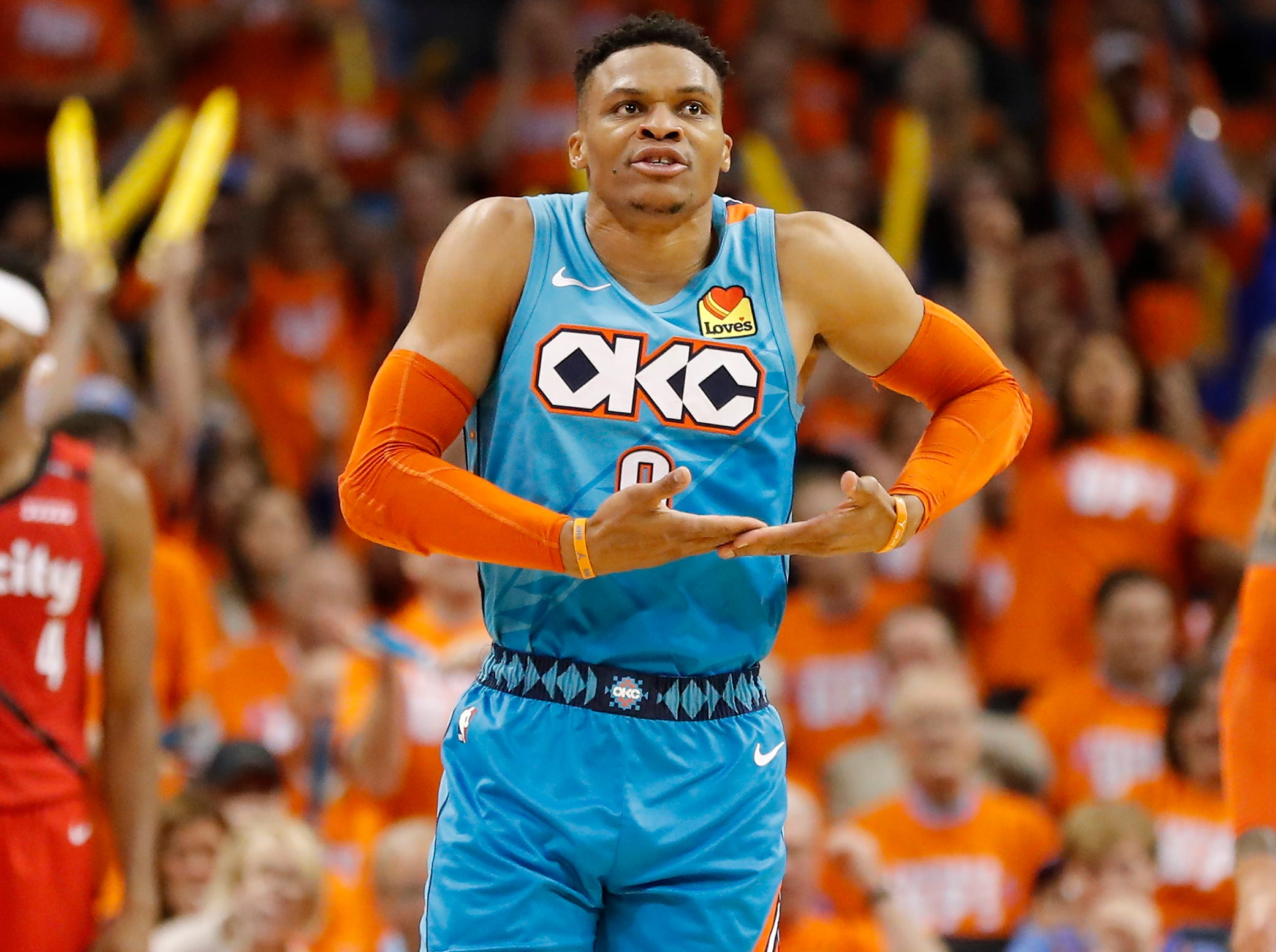 April 19: Thunder guard Russell Westbrook rocks the baby after a big second-half bucket during Game 3 against the Trail Blazers.