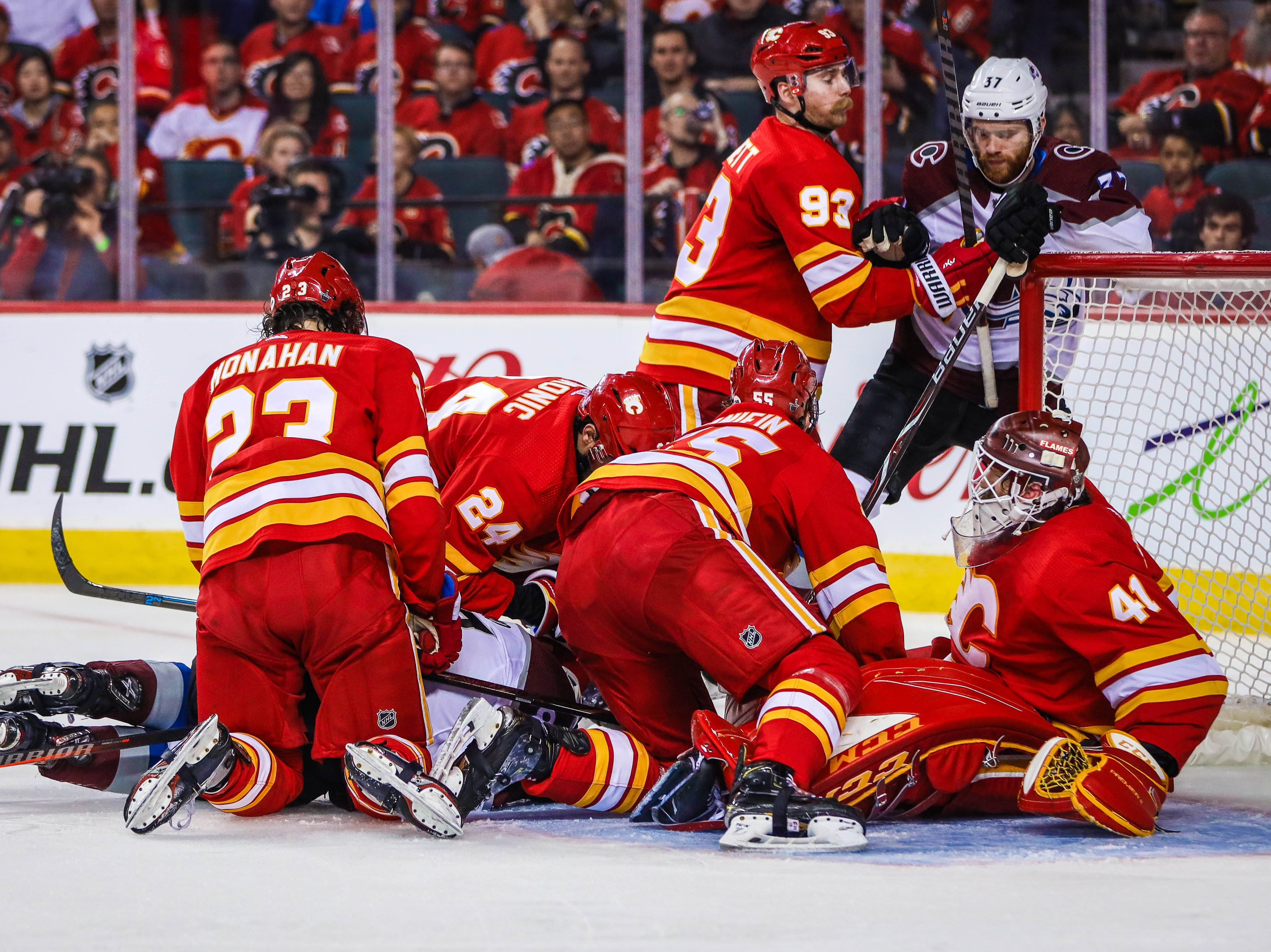 First round: Calgary Flames goaltender Mike Smith makes a save against Colorado Avalanche forward Matt Nieto (83) during the second period of Game 5. The Avs closed out the series with a 5-1 win.