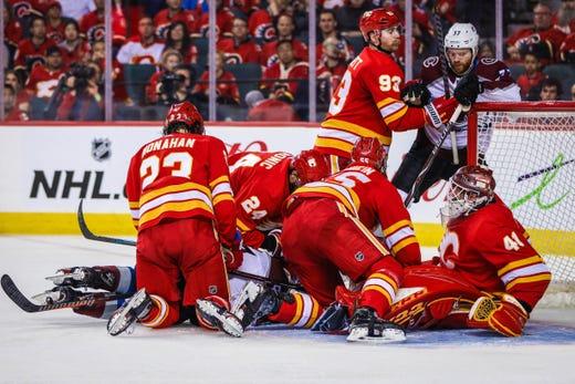 3c212994536 First round  Calgary Flames goaltender Mike Smith makes a save against  Colorado Avalanche forward Matt