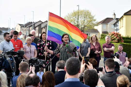 Mary Lou McDonald, Leader of Sinn Fein holds up a rainbow flag as she speaks at a rally for journalist and author Lyra McKee near the scene of her shooting on April 19 in Londonderry, Northern Ireland.  Journalist and Author Lyra McKee was killed in a 'terror incident' while reporting from the scene of rioting in Derry's Creggan neighborhood after police raided properties in the Mulroy Park and Galliagh area on the night of April 18.
