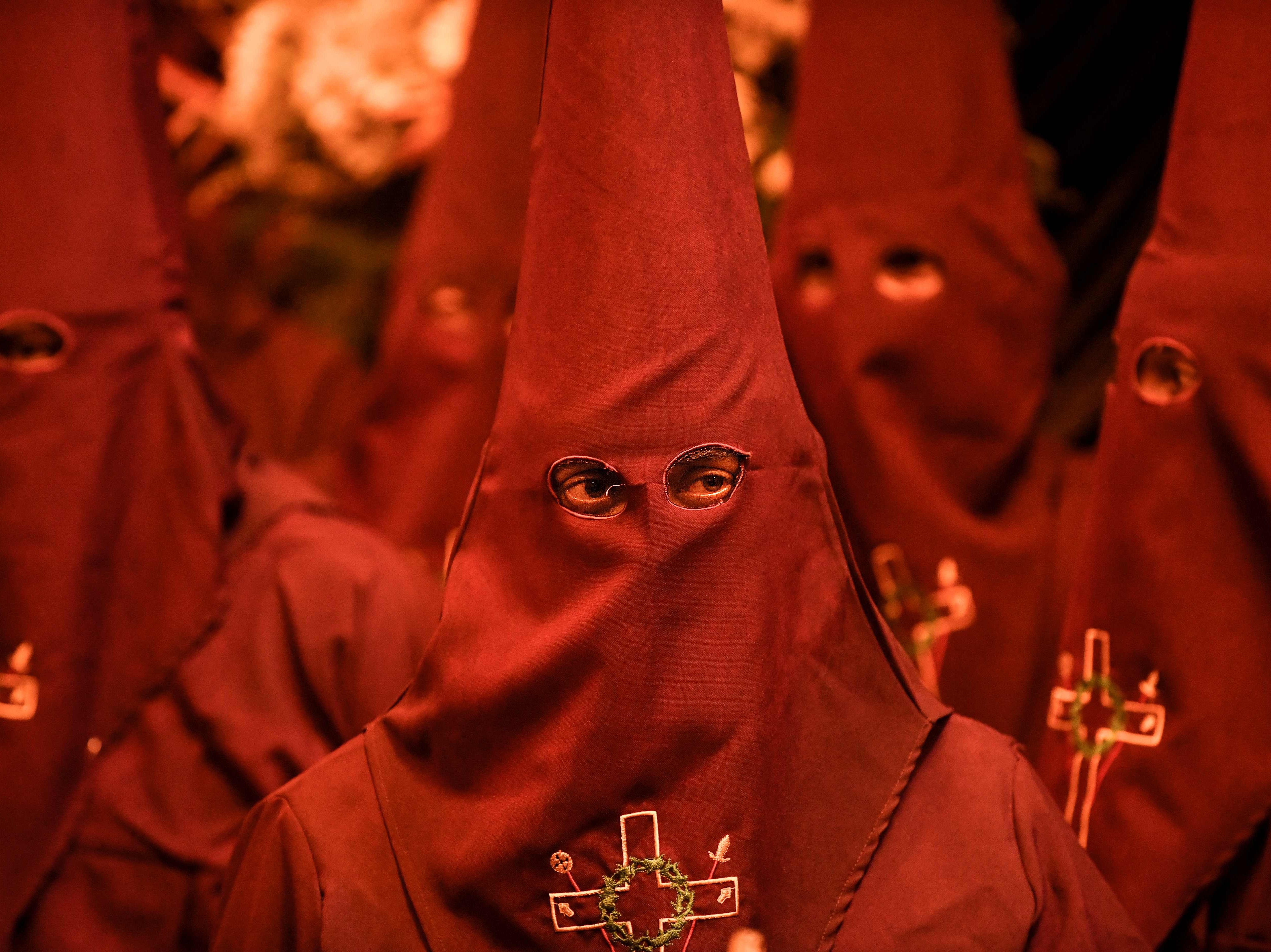 Members of the Nazarenos brotherhood take part of a Goof Friday procession during Holy Week celebrations in Zipaquira, Colombia, on April 19, 2019.
