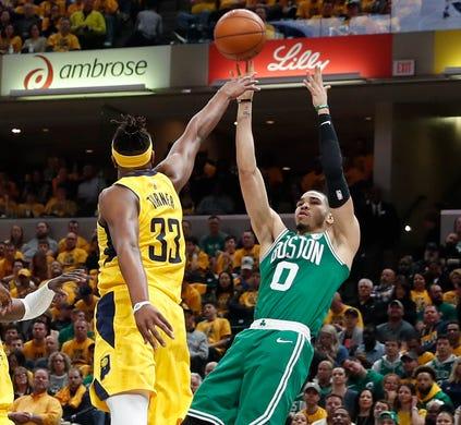 April 19: Celtics forward Jayson Tatum (0) shoots the fallaway jumper over Pacers defender Myles Turner (33) during Game 3.