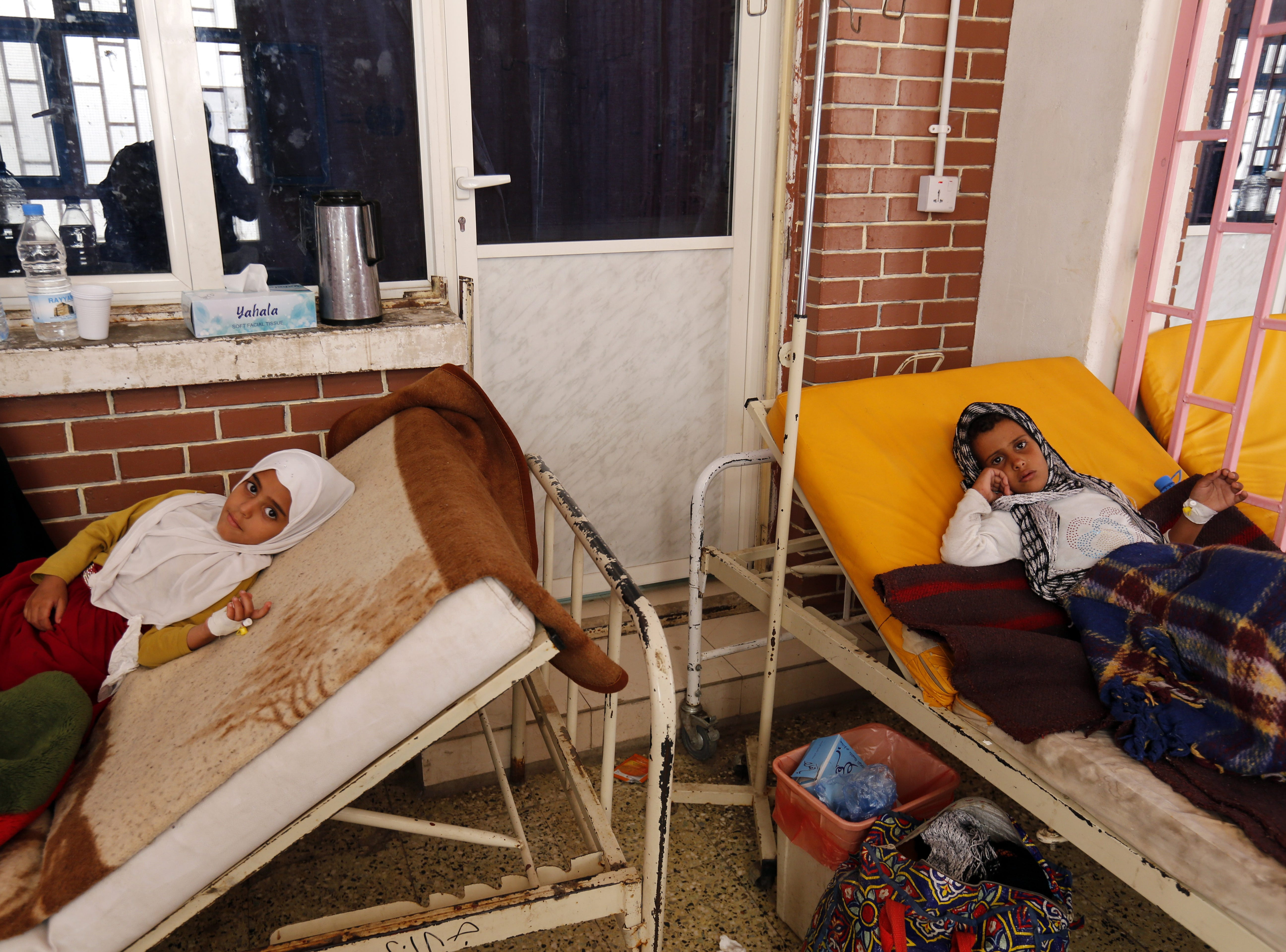 Two cholera-infected children receive treatment at a cholera treatment center amid a cholera outbreak, in Sana'a, Yemen on April 20, 2019.