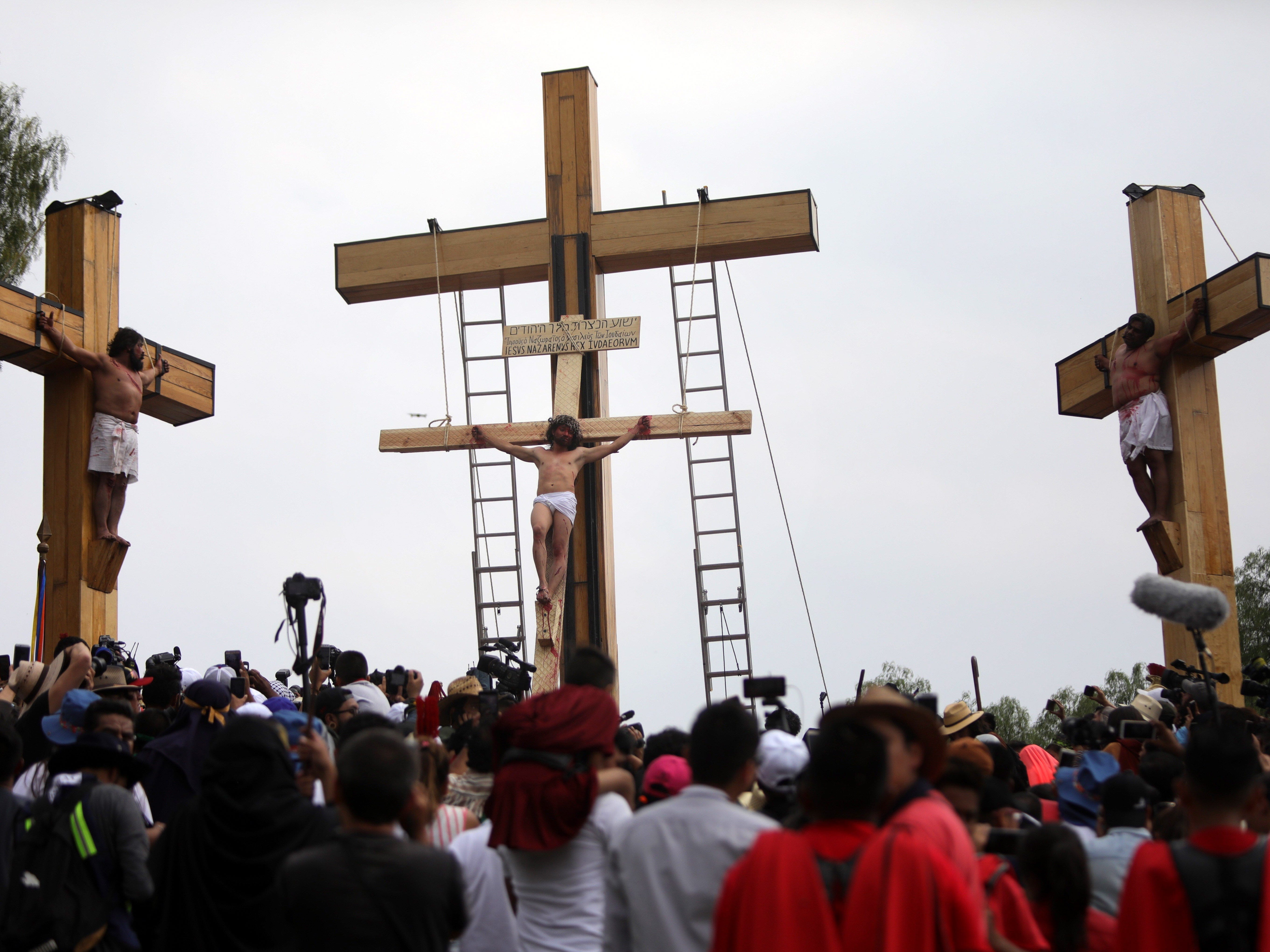 Hundreds of people participate in the representation of the viacrucis, in Iztapalapa, Mexico on April 19, 2019.