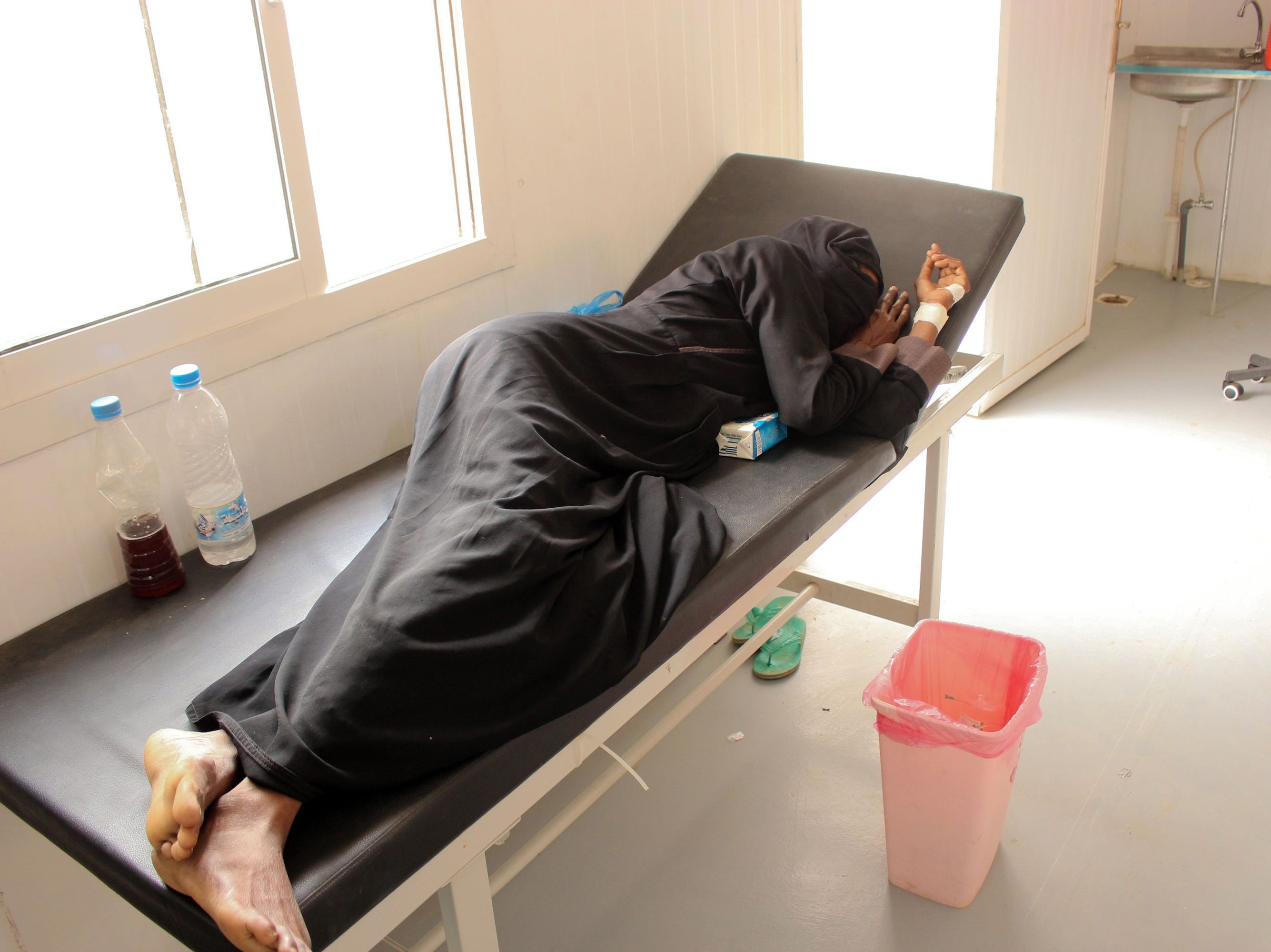 "A Yemeni woman lies on a bed at a Cholera treatment center in Yemen's northwestern Hajjah province on April 20, 2019. Oxfam has warned that war-torn Yemen risks a ""massive resurgence"" of cholera, with around 195,000 suspected cases of the disease recorded so far this year."