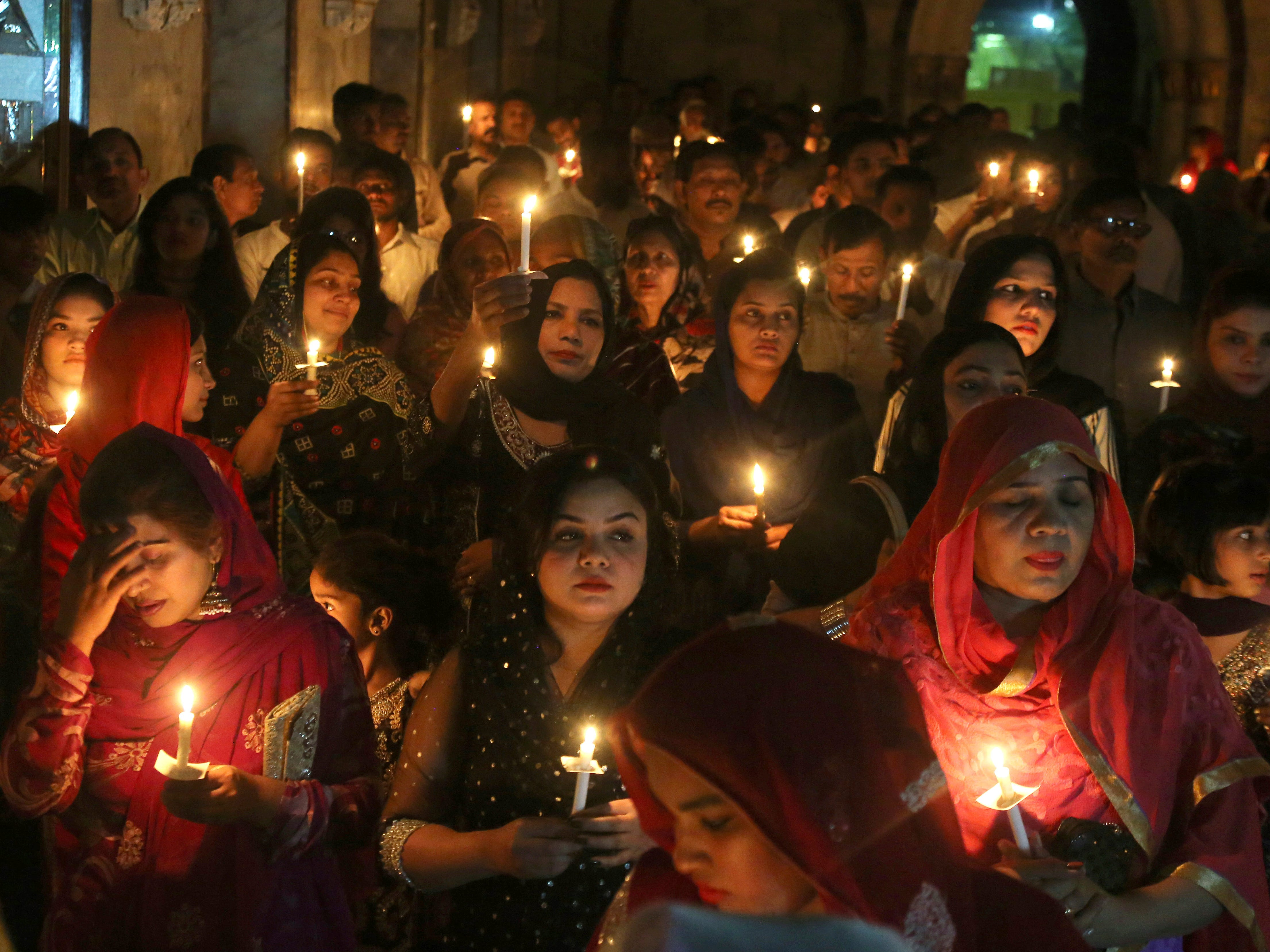 Pakistani Christians attend midnight Easter mass at St. Anthony Church in Lahore, Pakistan, Saturday, April 20, 2019. Christians across the world are celebrating Easter, commemorating the day followers believe Jesus was resurrected in Jerusalem 2,000 years ago.