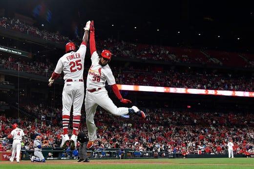 April 19: St. Louis Cardinals right fielder Jose Martinez (38) celebrates with center fielder Dexter Fowler (25) after hitting a home run against the New York Mets.