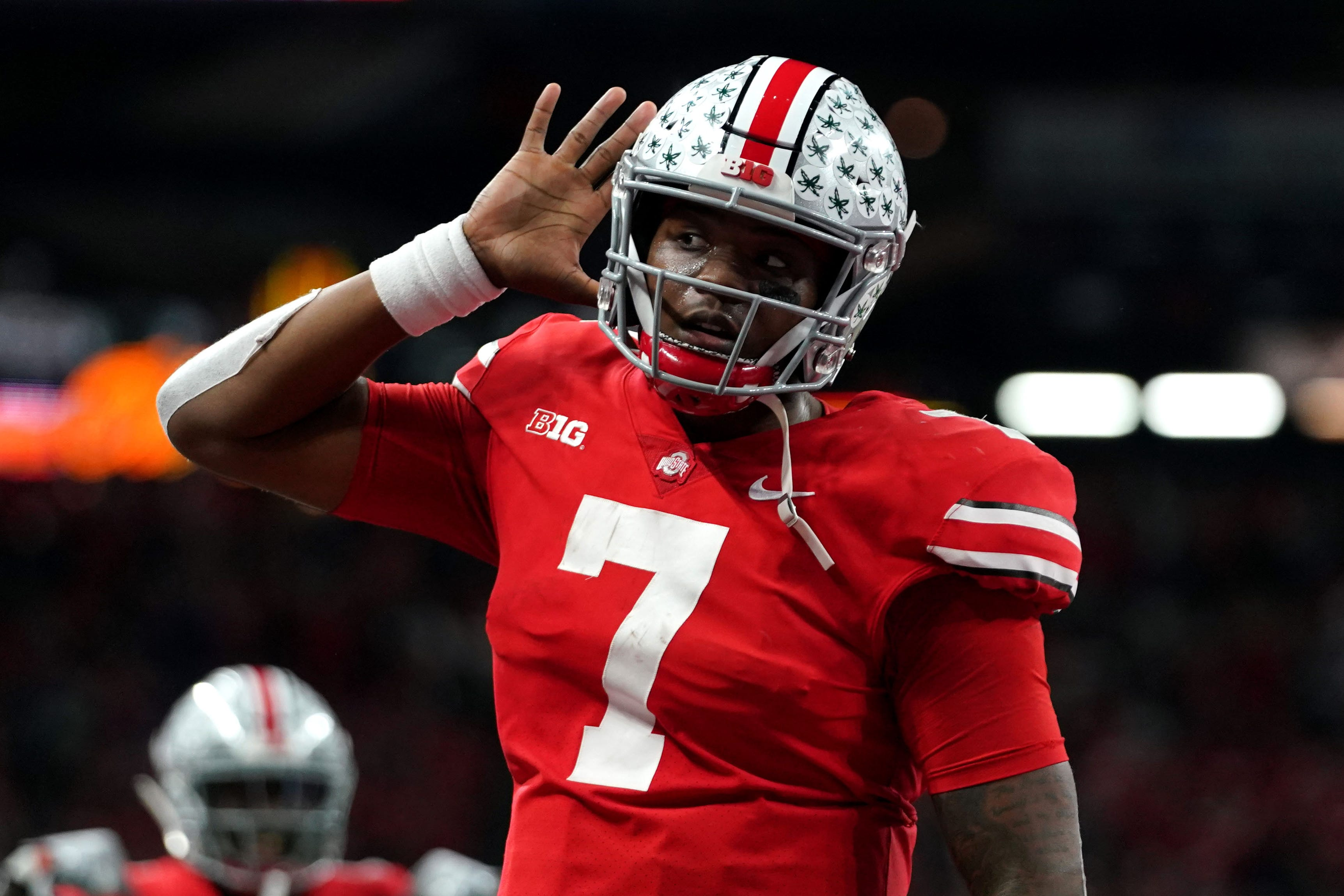 Dec 1, 2018; Indianapolis, IN, USA; Ohio State Buckeyes quarterback Dwayne Haskins (7) celebrates with teammates after throwing a touchdown pass against the Northwestern Wildcats in the first half in the Big Ten conference championship game at Lucas Oil Stadium. Mandatory Credit: Aaron Doster-USA TODAY Sports