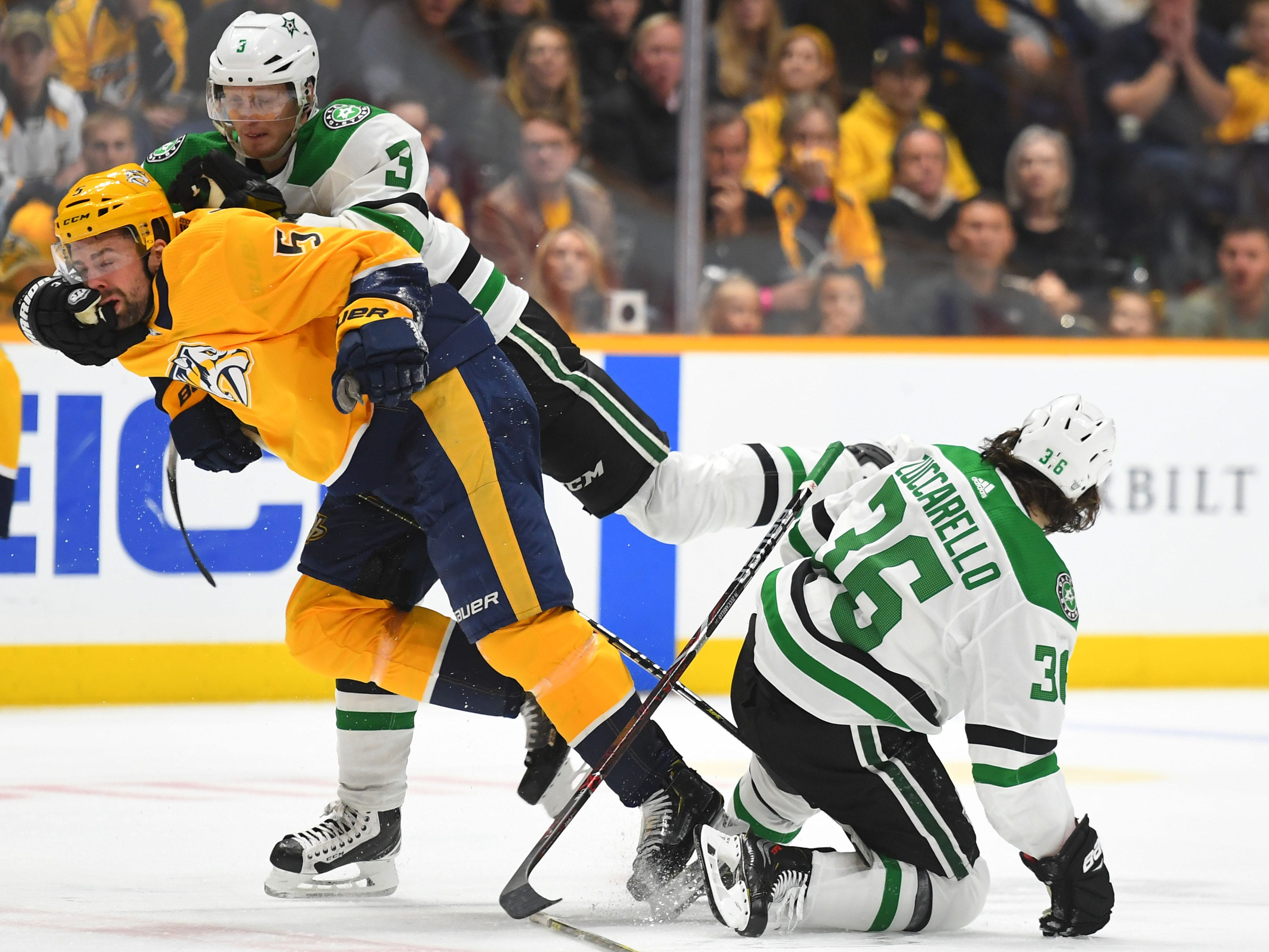 First round: Stars defenseman John Klingberg (3) jumps on Predators defenseman Dan Hamhuis (5) after a hit on Stars center Mats Zuccarello (36) during the second period of Game 5 in Nashville. The Stars won 5-3 to take a 3-2 series lead.