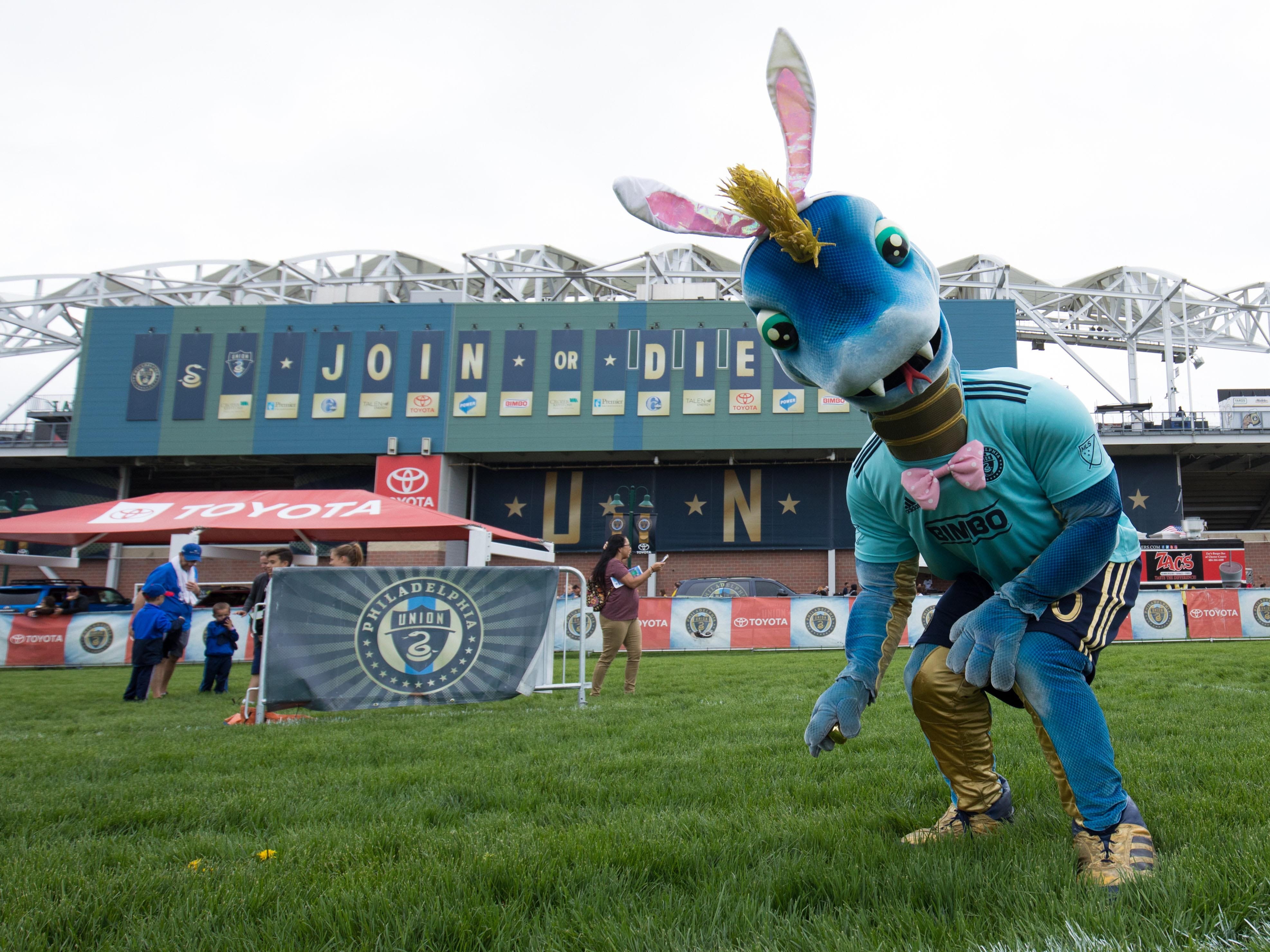 Philadelphia Union mascot Phang searches for Easter Eggs outside Talen Energy Stadium before a game against the Montreal Impact in Philadelphia.