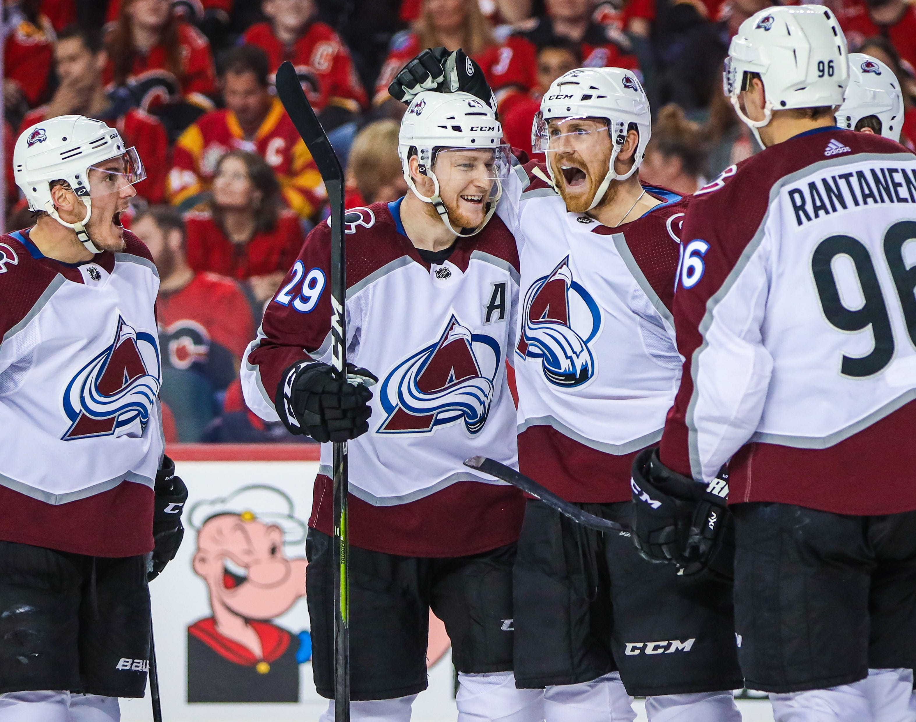 The Colorado Avalanche's Colin Wilson celebrates with teammates after scoring a goal in the series-clinching win over the Calgary Flames.