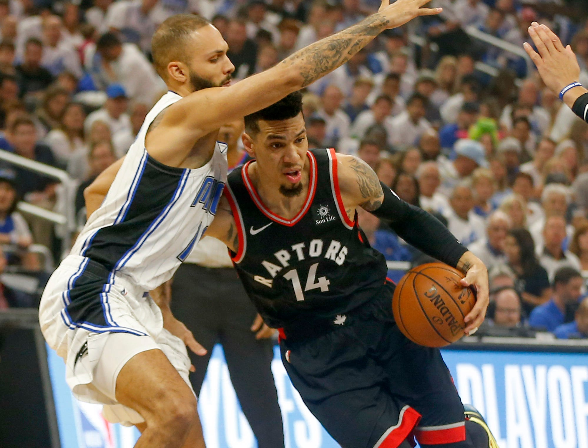 April 19: Raptors guard Danny Green (14) tries to drive against Magic defender Evan Fournier (10) during Game 3.