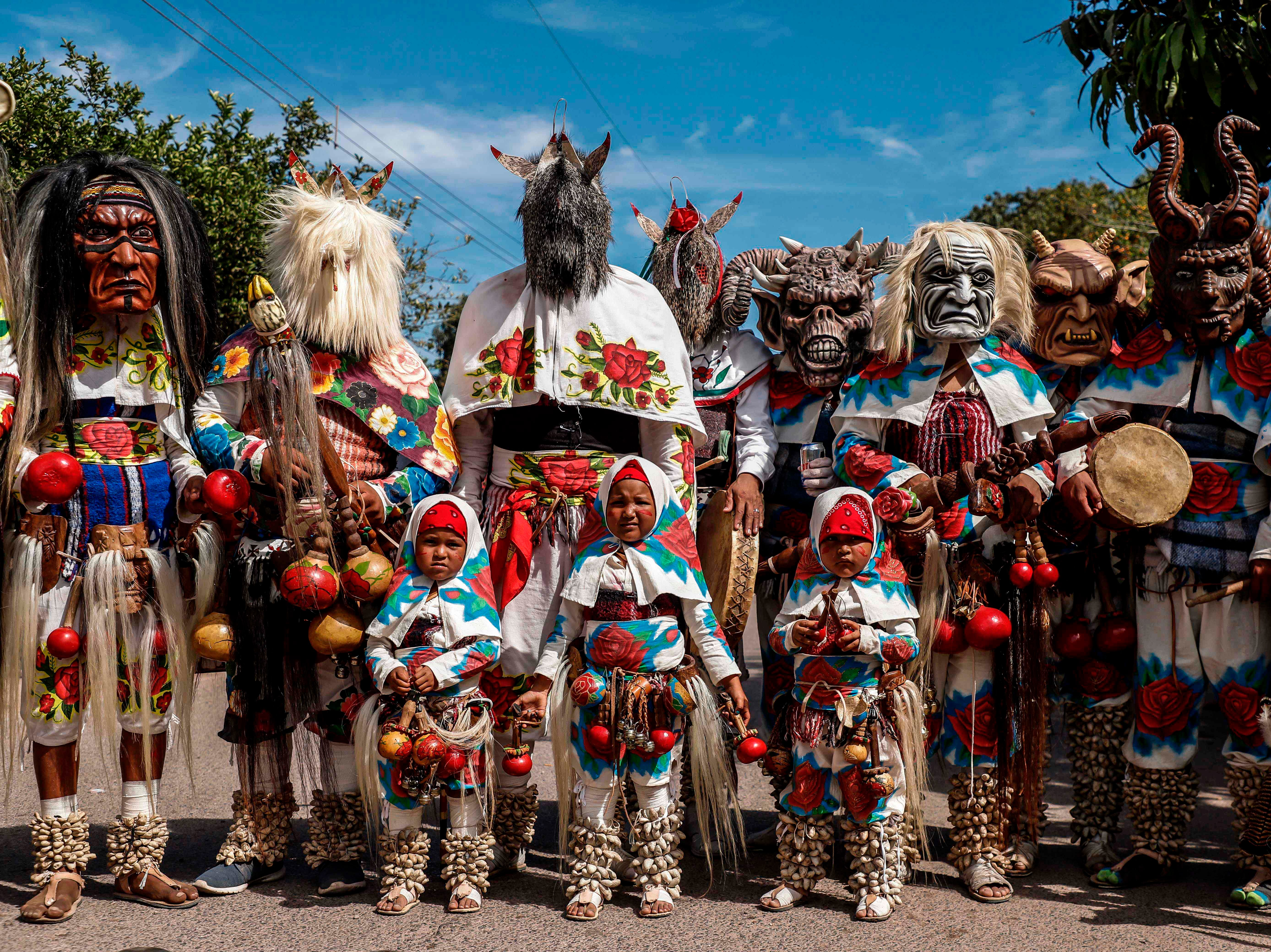 Members of the Mayo-Yoreme ethnic group celebrate Holy Week in their typical costumes dancing in San Miguel Zapotitlan, Sinaloa state, Mexico on April 19, 2019.