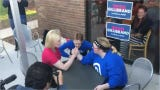 Democratic presidential candidate Sen. Kirsten Gillibrand is challenged to an arm-wrestling bout with a 20-year-old college student during a campaign stop in Iowa.